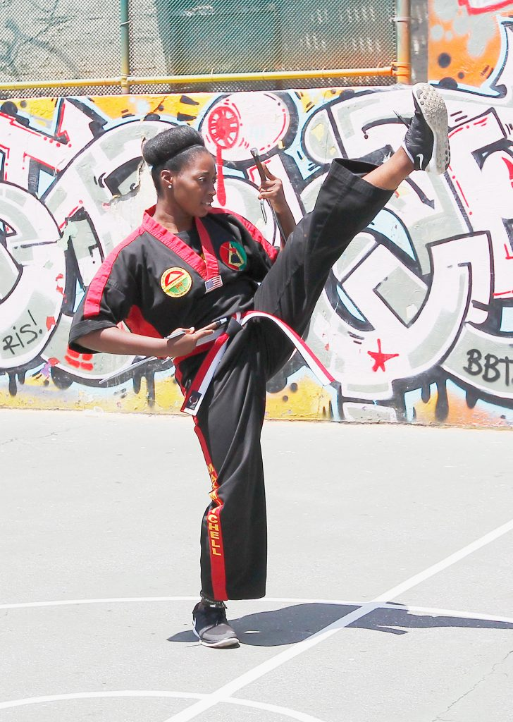 NEW YORK, NY - JUNE 14: A member of the Laureus Foundation Fight Back Project performs martial arts during the Laureus- New York Project Visit at the Mary Mitchell Family & Youth Center in The Bronx on June 14, 2015 in New York City. (Photo by Andy Marlin/Getty Images for Laureus)